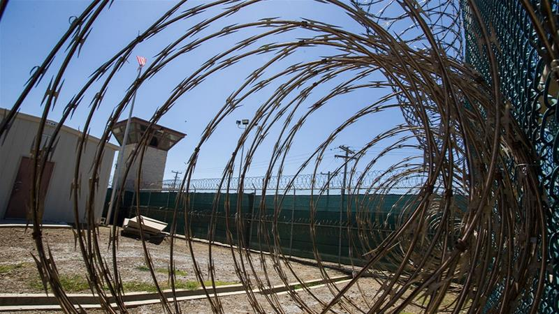 Control tower as seen through razor wire inside the Camp VI detention facility in Guantanamo Bay Naval Base, Cuba [Alex Brandon/AP Photo]