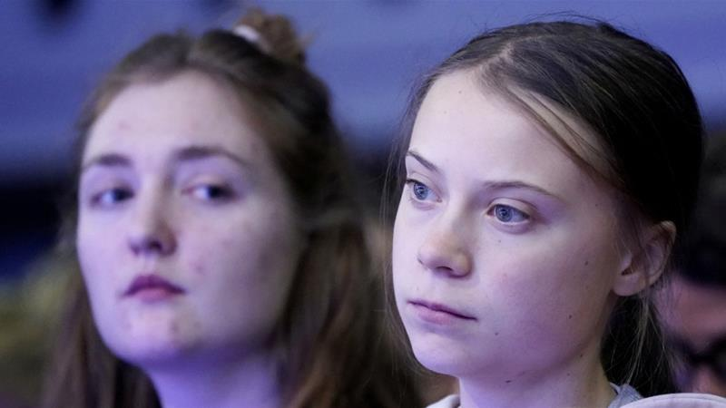 Swedish climate change activist Greta Thunberg and Swiss activist Loukina Tille attend a session at the 50th World Economic Forum annual meeting in Davos Switzerland