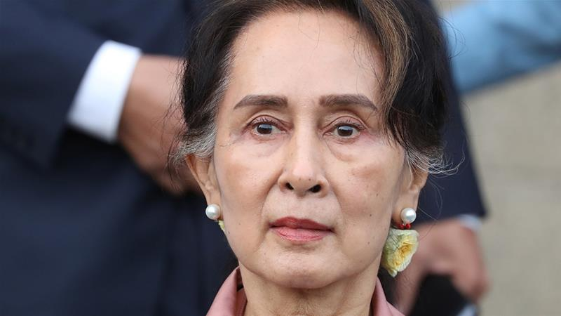 Aung San Suu Kyi leaves a hearing in a case filed by The Gambia against Myanmar alleging genocide against the minority Muslim Rohingya population, at the International Court of Justice in The Hague, Netherlands on December 10, 2019 [Yves Herman/Reuters]