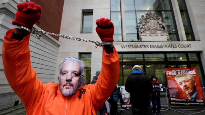 Supporters gathered outside a previous court hearing at which Julian Assange 'seemed frail and confused', January 23, 2020 [File: Kirsty Wigglesworth/AP]