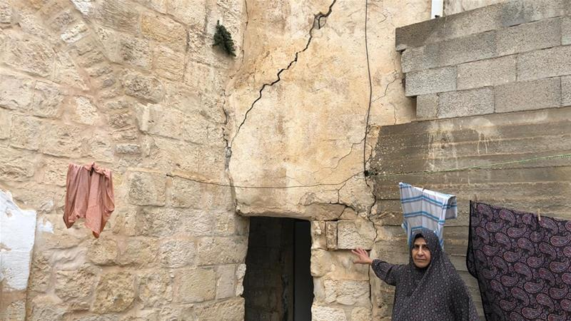 Hanan Slaima says the large cracks her home has sustained due to underground renovations by an Israeli company has made life difficult [Dareen Jubeh/Al Jazeera]
