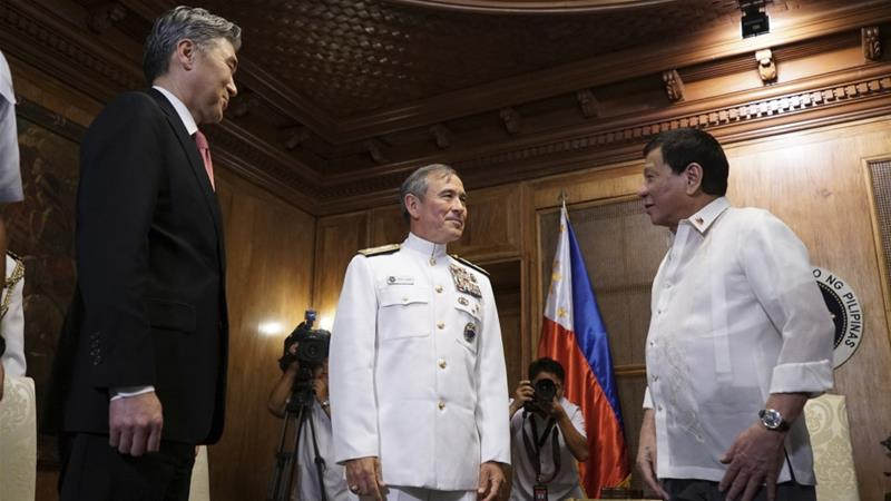 Duterte (right) receives US Pacific Command chief Adm Harry Harris Jr, (centre), and US Ambassador to the Philippines Sung Kim during a courtesy call at the presidential palace in Manila in 2017 [File: Albert Alcain/Malacanang Palace via AP]
