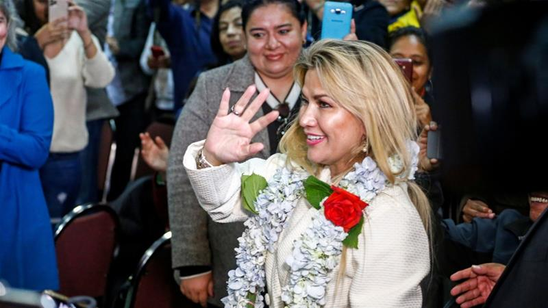 Anez waves to her supporters before a ceremony to announce her nomination as presidential candidate [David Mercado/Reuters]