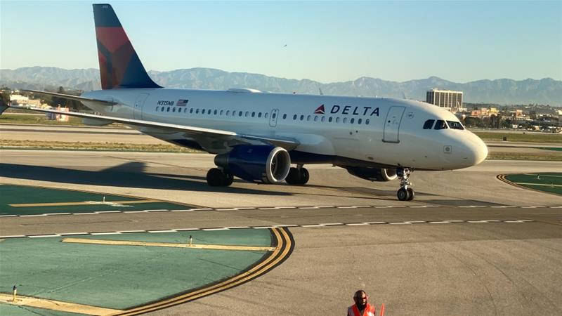 US Department of Transportation said Delta violated anti-bias laws by removing the passengers [File: Lucy Nicholson/Reuters]