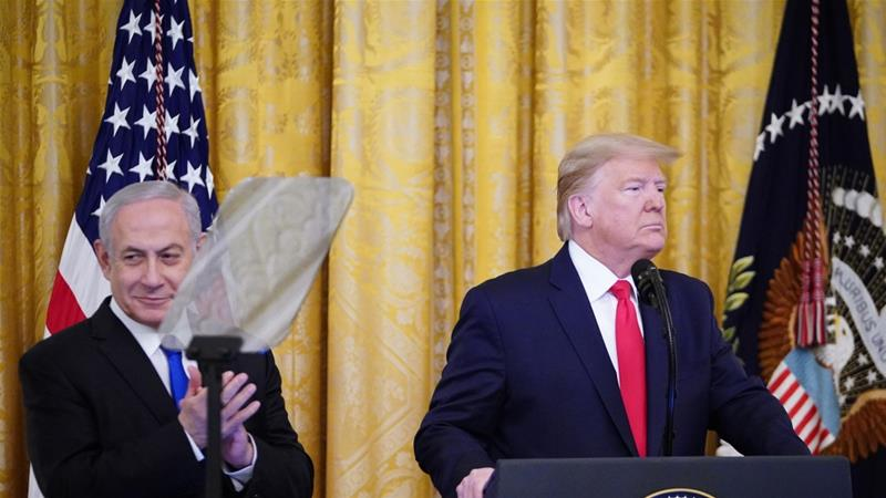 Israeli Prime Minister Benjamin Netanyahu and US President Donald Trump take part in an announcement of Trump's Middle East peace plan [Mandel Ngan/AFP]