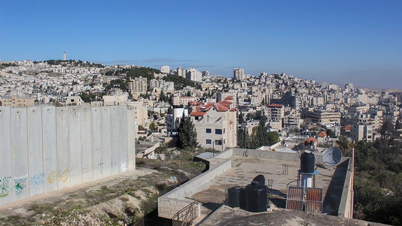 Abu Dis is part of Jerusalem governorate, but lies outside the municipal limits of the city [Arwa Ibrahim/Al Jazeera]