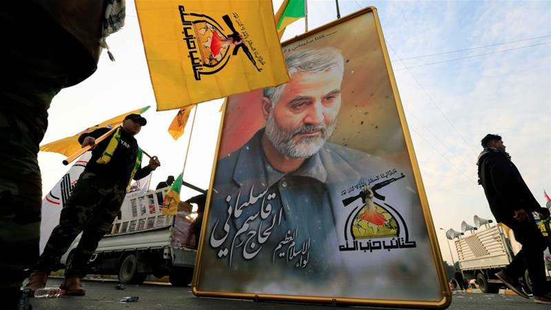 Kataib Hezbollah Iraqi militia hold a picture of the Iranian Major General Qassem Soleimani, January 4, 2020 [Thaier al-Sudani/ReutersDaylife]