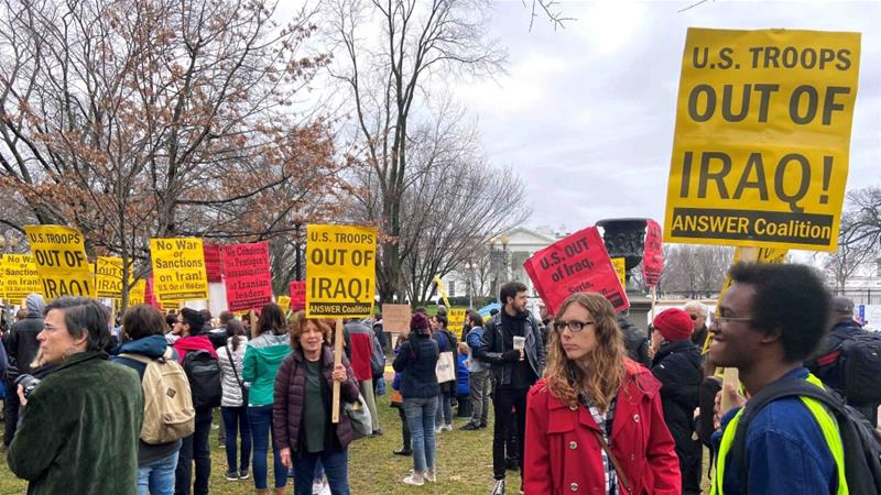 Anti-war protesters gather near the White House to condemn the US air strike that killed Iranian military commander Qassem Soleimani, in Washington, on January 4, 2020 [Reuters/Jan Wolfe]