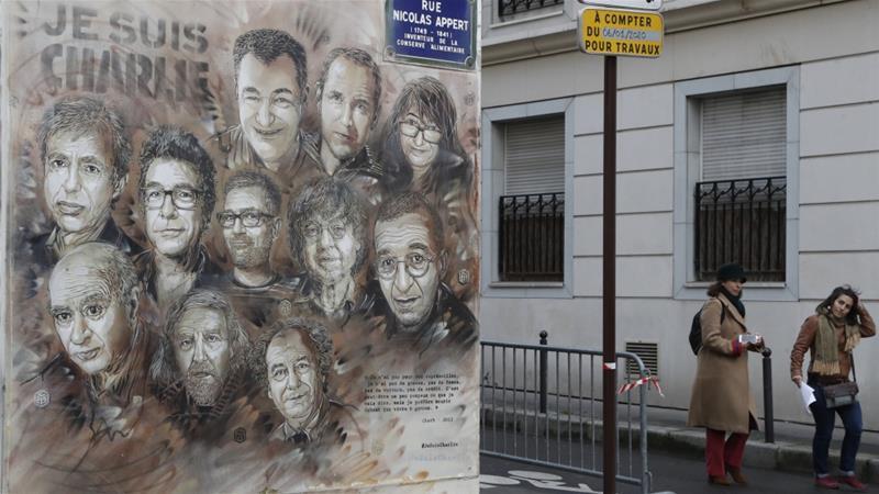 Karya seni yang menggambarkan anggota majalah satir Charlie Hebdo [File: Francois Guillot / AFP]