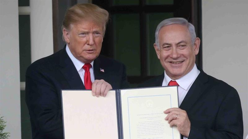 US President Donald Trump and Israel's PM Benjamin Netanyahu hold up a proclamation recognising Israel's sovereignty over the Golan Heights on March 25, 2019 [File: Reuters/Leah Millis]
