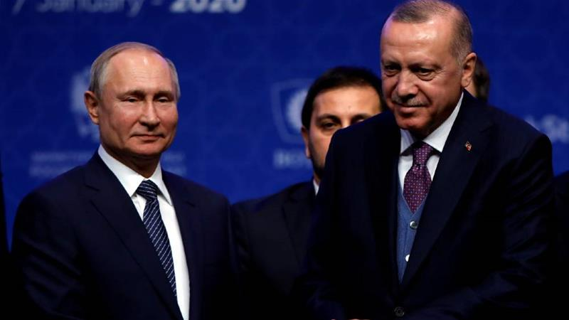 Putin, left, and Erdogan attend a ceremony marking the formal launch of the TurkStream pipeline [Umit Bektas/Reuters]