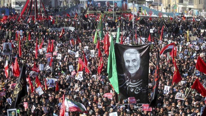 Mourners attend a funeral ceremony for General Qassem Soleimani