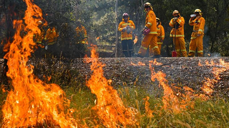 Australians are being urged to evacuate as giant fires threaten to regenerate with high winds and hot temperatures [Jason Edwards/AAP Image via Reuters]