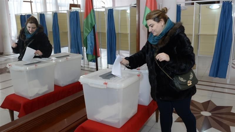 A woman votes at a polling station during the parliamentary elections, in Baku on February 9, 2020 [Tofik Babayev/AFP]