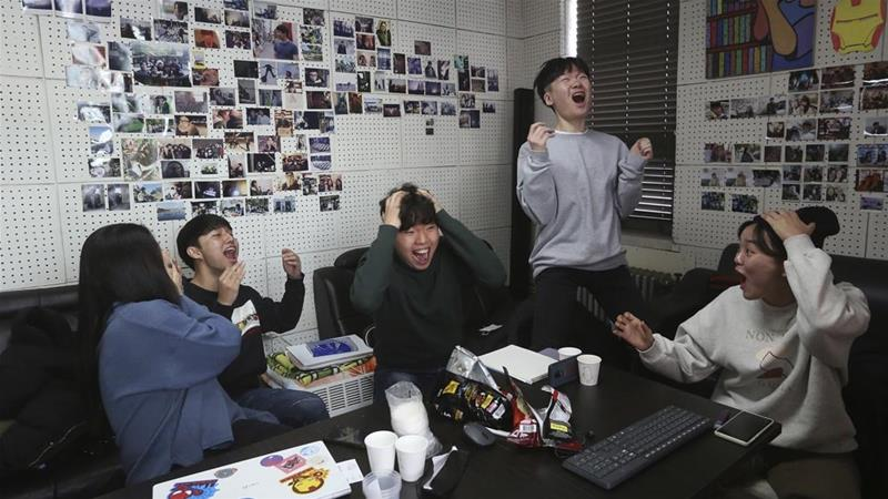 South Koreans reacted with rare collective joy on Monday after director Bong Joon-Ho's Parasite won the Oscar for best picture and three other awards [Ahn Young-joon/AP Photo]