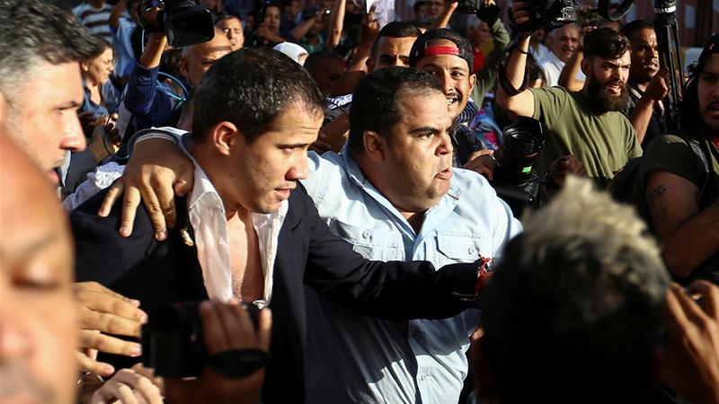 Opposition leader Guaido returns to Venezuela after tour