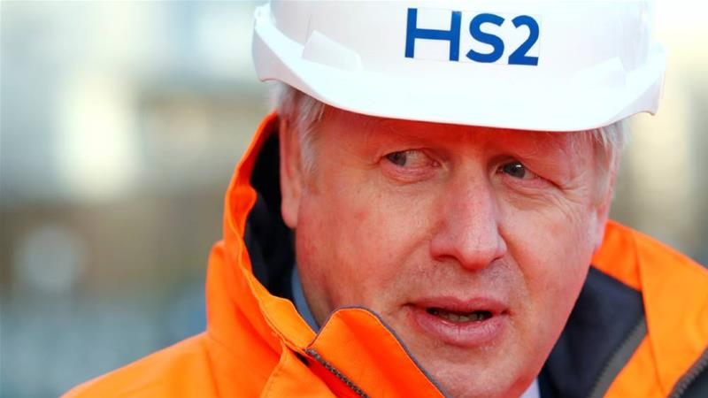 Boris Johnson visited an HS2 construction site in Birmingham on Tuesday, in advance of his announcement [Eddie Keogh/Pool/Reuters]