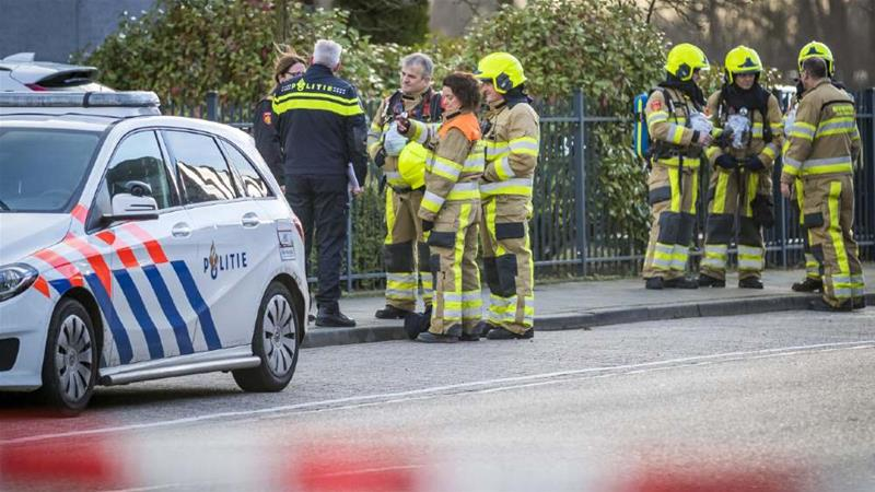 Emergency services attend to the site of a letter bomb detonation in the city of Kerkrade