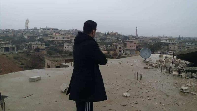 Dr Tarraf on the roof of his home after it was bombed for the first time [Photo courtesy of Dr Tarraf]
