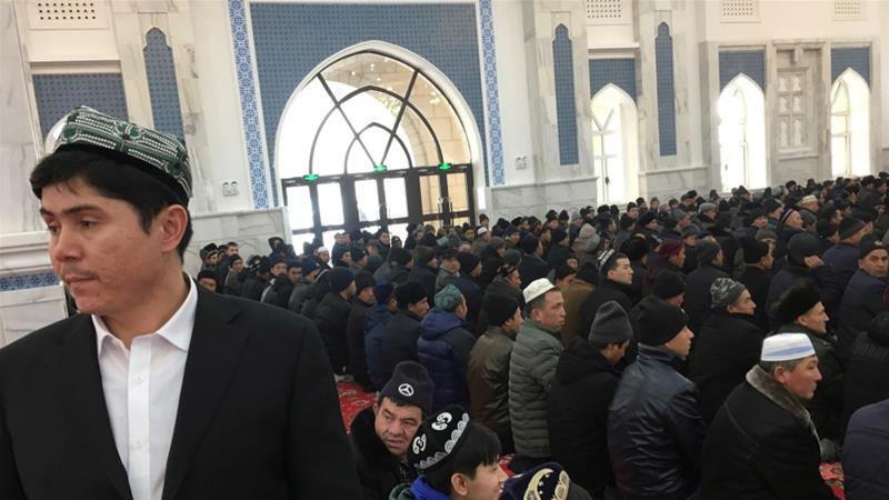 Men seen praying at the mosque at the Xinjiang Islamic Institute Urumqi, Xinjiang Uighur Autonomous Region, China, January 3, 2019 [Ben Blanchard/Reuters]
