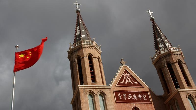 The Chinese national flag flies in front of an underground Catholic church in the village of Huangtugang, Hebei province, China [File: Thomas Peter/Reuters]