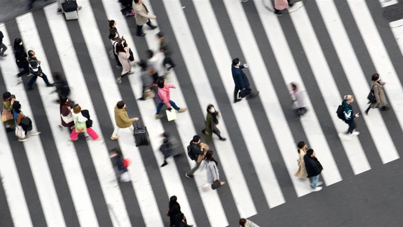 Japan's economy shrinks at fastest pace in six years, virus clouds outlook