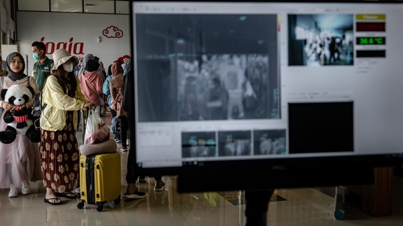 Passengers have their temperature checked as they pass a thermal scanner monitor at the Adisucipto International Airport on January 23, 2020 in Yogyakarta, Indonesia [Ulet Ifansasti/Getty Images]