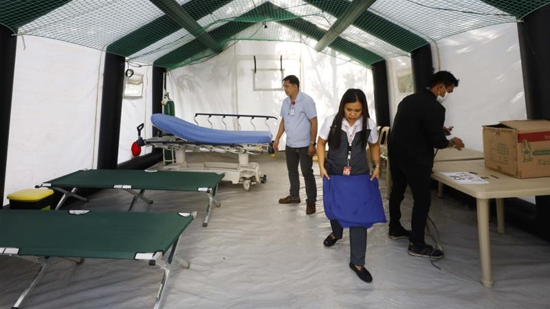 Staff at a hospital in Manila prepare the equipment of an isolation tent installed for patients who will manifest symptoms that could be investigated for coronavirus Rolex dela PenaEPA