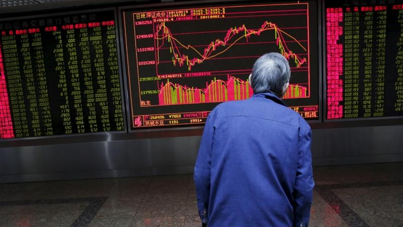Investors retreated from Asian stocks and currencies on Monday as the coronavirus outbreak continued spreading beyond China [File: Kim Kyung-Hoon/Reuters]