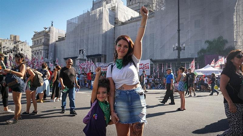 Maite Linares and her daughter Juana rally to legalize abortion in Argentina outside the Argentine Congress in Buenos Aires [Natalie Alcoba/Al Jazeera]