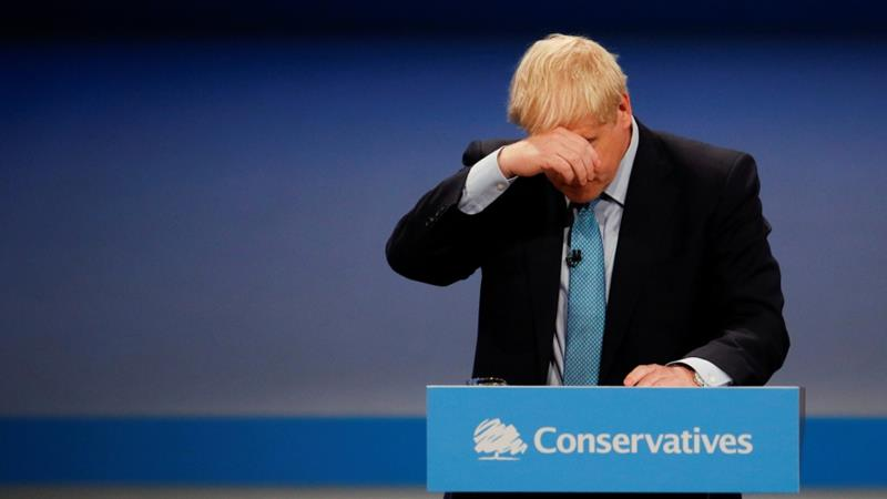 UK Prime Minister Boris Johnson reacts as he gives a closing speech at the Conservative Party annual conference in Manchester, Britain, October 2, 2019 [File: Phil Noble/Reuters]