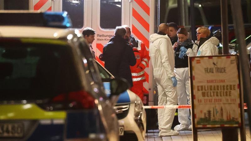Forensic experts are seen outside a shisha bar after a shooting in Hanau near Frankfurt late on Wednesday [Kai Pfaffenbach/Reuters]