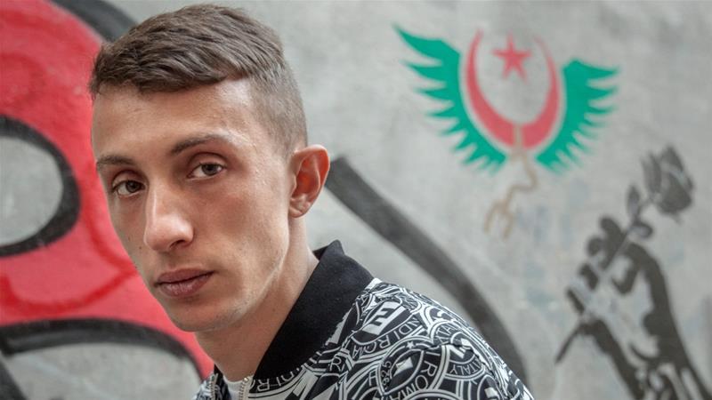 Algerian poet and former political prisoner Mohamed Tadjadit [Lydia Saidi / Al Jazeera]