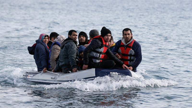 Migrants from Afghanistan on a dinghy approach a beach on the island of Lesbos, Greece [File: Costas Baltas/Reuters]