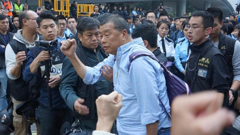 Publisher, 2 politicians charged over Hong Kong protests
