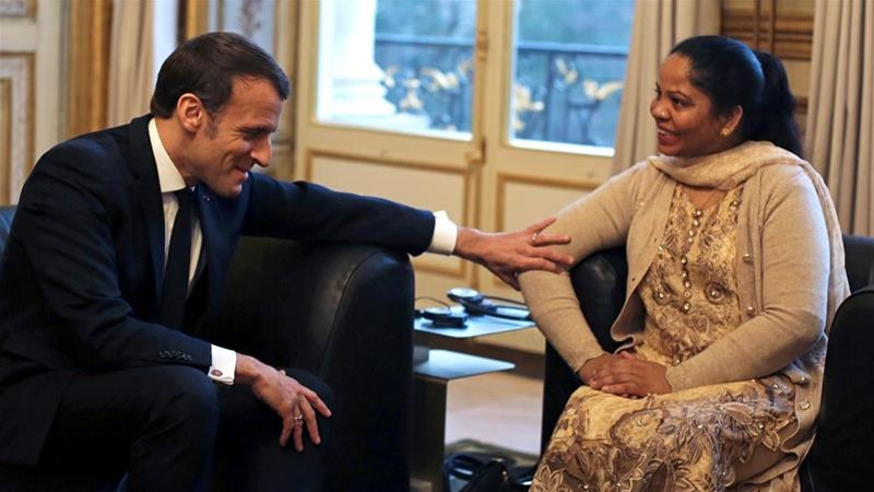 Aasia Bibi, a Christian woman who was acquitted of blasphemy in Pakistan, met French President Emmanuel Macron at the Elysee Palace in Paris [Rafael Yaghobzadeh/Reuters]