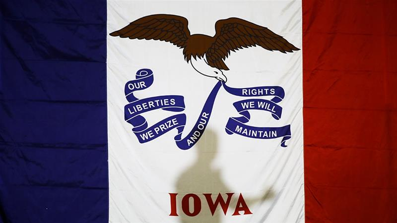 Democratic presidential candidate former South Bend, Ind., Mayor Pete Buttigieg's shadow is cast on the Iowas state flag as he speaks during a campaign event [Matt Rourke/AP Photo]