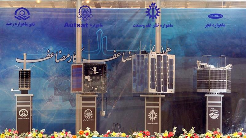 Iran's prototypes of home-built satellites - (from left) Rasad, Amir Kabir-1, Zafar and Fajr - on display during a 2011 ceremony [Vahidreza Alaei/AFP]
