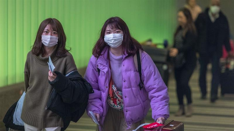 Flights have been suspended and travel banned to and from cities in China as the new coronavirus continues to claim more lives [File: David McNew/AFP]