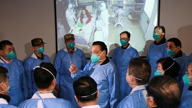 Chinese Premier Li Keqiang speaks to medical workers as he visits the Jinyintan hospital where patients who have coronavirus are being treated in Wuhan, China [File: CNS Photo via Reuters]