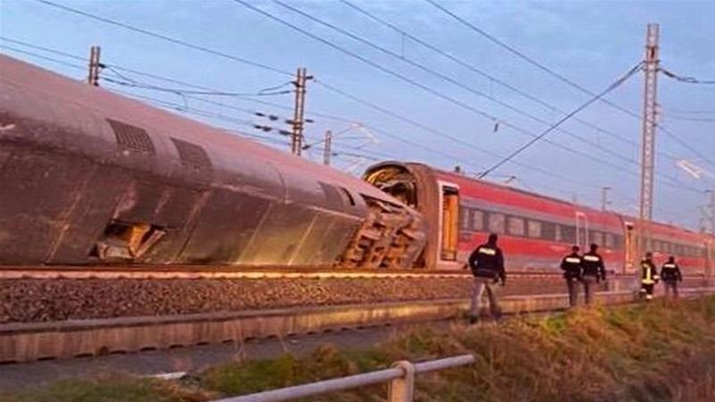 A handout photograph taken and released by the Italian police, Polizia di stato, on February 6, 2020, shows the derailed train outside the city of Lodi, near Milan, northern Italy [Polizia di Stato/AFP]