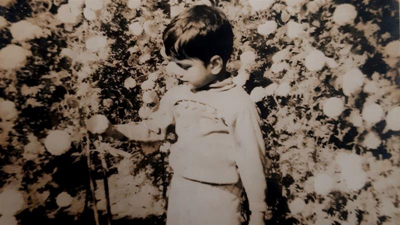 Manash as a boy, pictured in the early 1970s in the garden of a neighbour, Ashim Sengupta, in Maligaon, which means 'the gardener's village', Assam [Photo courtesy of Manash Firaq Bhattacharjee]