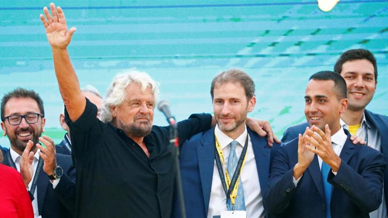 Co-founder Beppe Grillo, Davide Casaleggio, son of co-founder Gianroberto Casaleggio, and Italian Deputy PM Luigi Di seen at a Five Star Movement party rally in October 2018 [File: Max Rossi/Reuters]