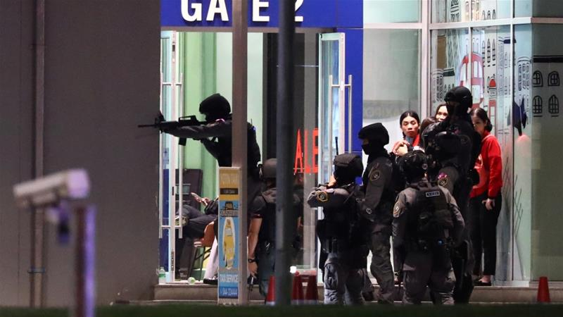 Thai security forces enter the shopping centre as they chase an attacker after a mass shooting [Athit Perawongmetha/Reuters]