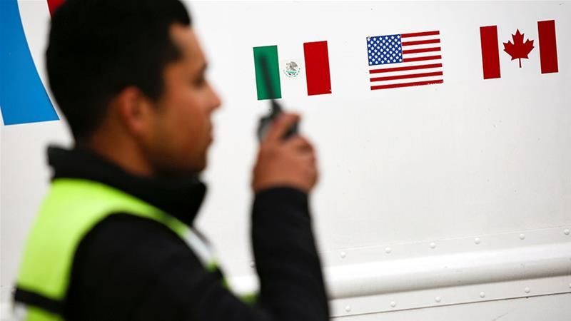 Flags of Mexico, United States and Canada are pictured at a security booth at Zaragoza-Ysleta border crossing bridge, in Ciudad Juarez, Mexico [File: Jose Luis Gonzalez/Reuters]