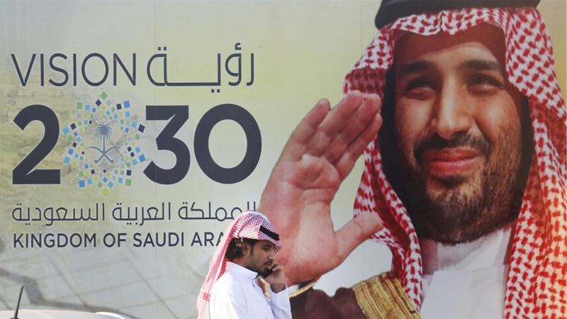 A banner advertises Saudi Crown Prince Mohammed bin Salman's Vision 2030 outside a mall in Jeddah, Saudi Arabia on February 5, 2020 [File: AP/Amr Nabil]