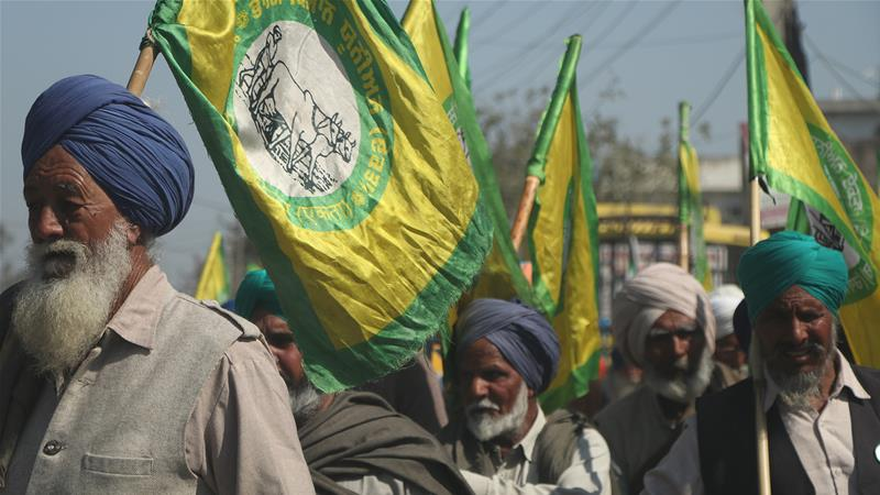 Protesters from surrounding districts arrived at Malerkotla in buses, waving the banners of the Bharti Kisan Union Ekta Ugraha, a farmer's union that was among the protest's organisers [Al Jazeera]