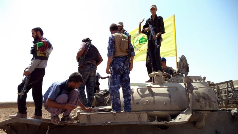 Kataib Hezbollah was one of the Iraqi militia groups that helped defeat the ISIL (ISIS) group in Iraq [File: Ali Mohammed/EPA]