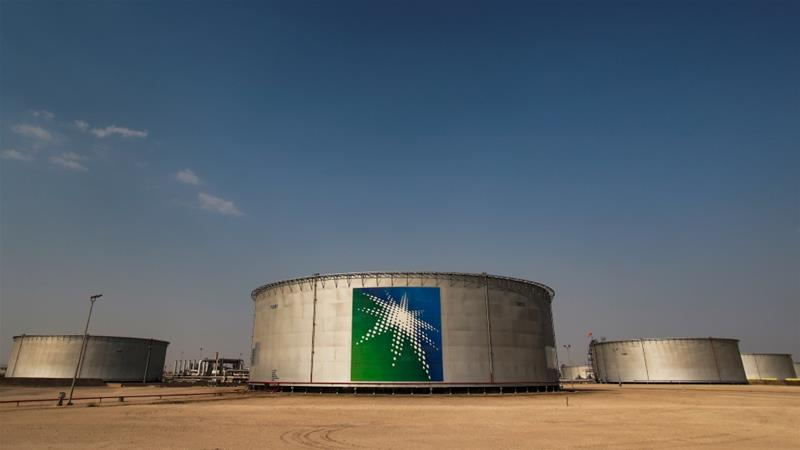 Oil tanks at the Saudi Aramco oil facility in Abqaiq, Saudi Arabia, which escalated its oil price war with Russia on Friday with Reuters reporting that the Saudis, in a market share grab from the Russians, will sell oil for as low as $25 a barrel [File: Maxim Shemetov/Reuters]