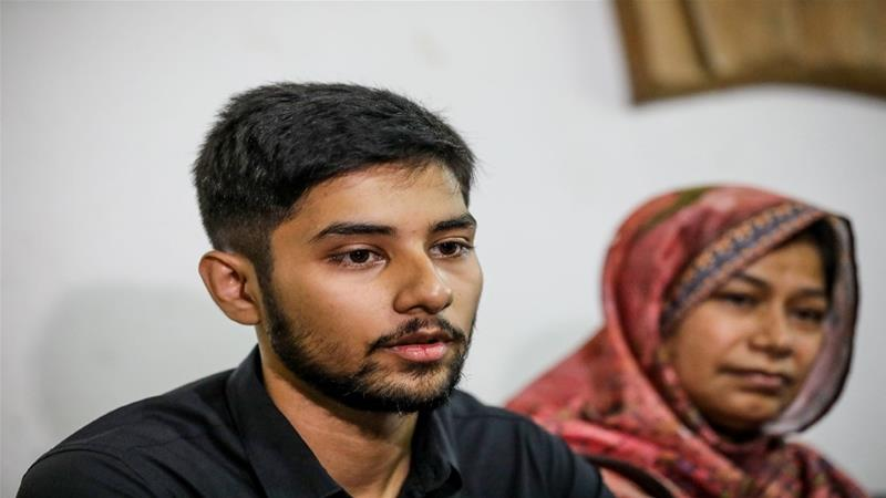 Monorom Polok, son of the recently disappeared journalist Shafiqul Islam Kazal, speaks to reporters at Dhaka's National Press Club [STR/AFP]